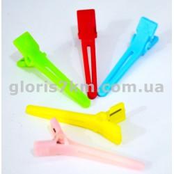 Зажим-уточка пластмасса цветной